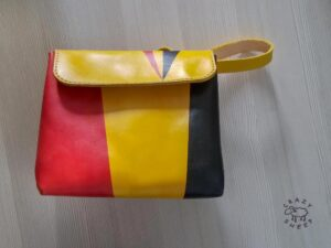 Small bright leather clutch bag